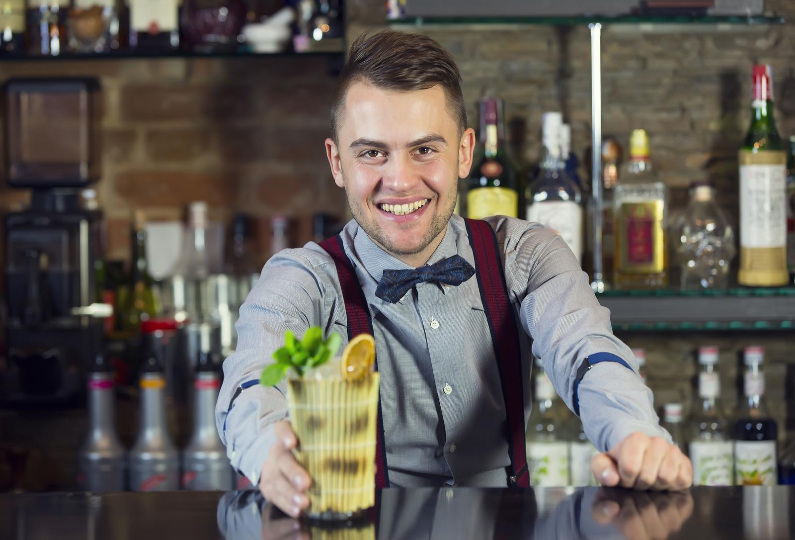 young man working as a bartender in a nightclub bar ** Note: Soft Focus at 100%, best at smaller sizes